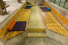 Seat made of wooden blocks and with multi-colored pillows Stock Images