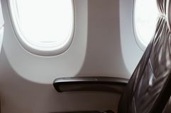 Seat near by window of passenger on the plane. royalty free stock images