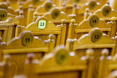Seat number 13. Empty rows of vintage chairs stock photo