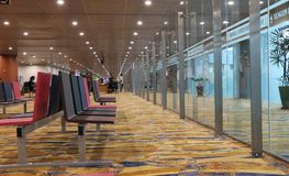 Seat for passenger sit and waiting to board with beautiful carpet in the Yangon International Airport. royalty free stock photo