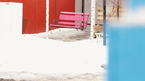 Seat pink swing in winter stock footage