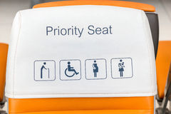 Seat priority information signs close-up on the seats Royalty Free Stock Image