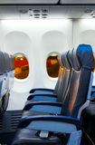 Seat rows in an airplane cabin. Royalty Free Stock Image