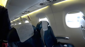 Seat rows in an airplane cabin stock footage