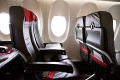 Seat rows in an airplane cabin. Photo of seat rows in an airplane cabin Royalty Free Stock Images