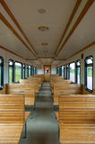 Seat rows in old passenger car. Rows of wooden seats in old passenger car of traditional train on the East Frisian island Langeoog, Lower Saxony, Germany Royalty Free Stock Image