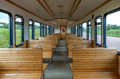 Seat rows in old passenger car. Rows of wooden seats in old passenger car of traditional train on the East Frisian island Langeoog, Lower Saxony, Germany Royalty Free Stock Images