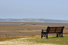 Seat on shore and view across Morecambe Bay Royalty Free Stock Photography