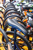 Seat sports bike on bicycle parking Royalty Free Stock Photography