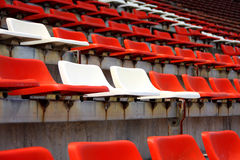 Seat in stadium on grand stand. Grand stand, orange and white seat in stadium. (in horizontal stock photography