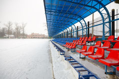 Seat on  stands in winter Stock Image