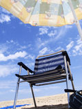 A seat in the sun. Beach chair on the sand stock photos