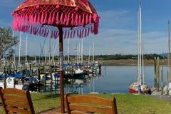 Seat and sunshade at Motueka Marina, New Zealand stock photos