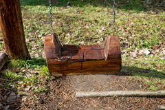 The seat of a swing made of tree trunks Royalty Free Stock Image