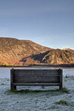 Seat with a view across Ennerdale Water. Vertical. Stock Image