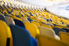 Seat for watch some sport o. Rows of empty blue seats with the numbers Stock Photography