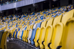 Seat for watch some sport o. Rows of empty blue seats with the numbers Stock Images