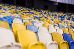 Seat for watch some sport o. Rows of empty blue seats with the numbers Royalty Free Stock Photos