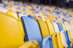 Seat for watch some sport o. Rows of empty blue seats with the numbers Royalty Free Stock Photo