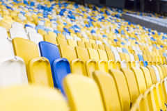 Seat for watch some sport o. Rows of empty blue seats with the numbers royalty free stock images
