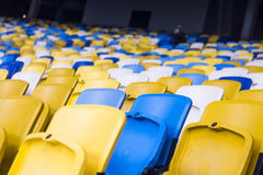 Seat for watch some sport o. Rows of empty blue seats with the numbers stock photos