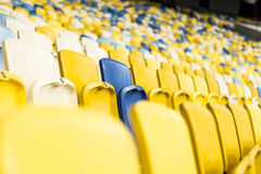 Seat for watch some sport o. Rows of empty blue seats with the numbers stock image