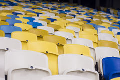 Seat for watch some sport o. Rows of empty blue seats with the numbers royalty free stock image