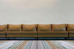 Seat on white wall with lights Royalty Free Stock Photo
