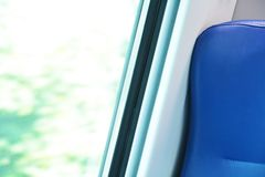 Seat and window in a modern train stock image