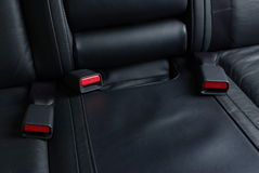 Seatbelt buckles on a car seat Stock Photos