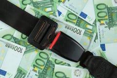 Seatbelt on euro banknotes Stock Image