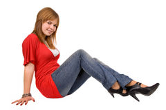 Seated. Young casual woman seated, isolated on white stock image