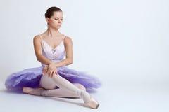Seated ballerina stock photo