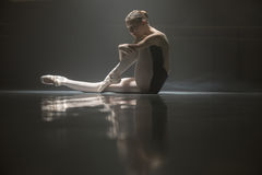 Seated ballerina in the class room Royalty Free Stock Photography