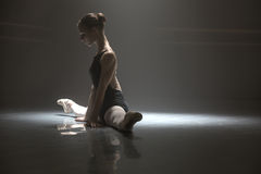 Seated ballerina in class room Royalty Free Stock Image