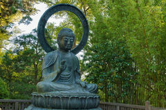 Seated Bronze Buddha at Japanese Garden Royalty Free Stock Image