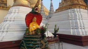 Seated Buddha image at The Shwedagon Pagoda stock photo