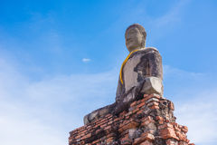 Seated buddha with sky. Ruin of seated buddha at wat Chaiwatthanaram in Ayutthaya, Thailand Stock Photos