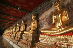 Seated Buddha states in a row at the temple of Wat Arun in Bangkok, Thailand Stock Photos