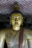 A seated Buddha statue in Cave 2 (Maharaja Viharaya) at the Dambulla Cave Temples in Sri Lanka. Stock Photos