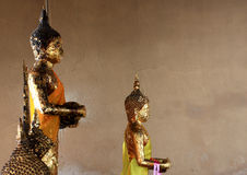 Seated buddha statue covered in gold leaf Royalty Free Stock Photo