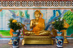 Seated Buddha Statue in Gold at Li Thi Miew Shrine Stock Photos