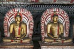 Seated Buddha statues in Cave 2 (Maharaja Viharaya) at the Dambulla Cave Temples in Sri Lanka. Royalty Free Stock Photos