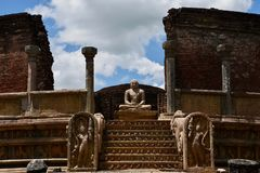 Seated Buddha in temple ruins Royalty Free Stock Image