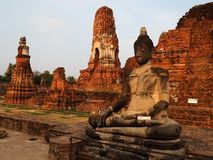 Seated Buddha and Wat Mahathat temple in Ayutthaya stock photography