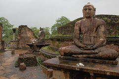 Seated Buddhas in Polonnaruwa Vatadage. Four seated Buddhas are located in the ancient house of relic in Polonnaruwa, Sri Lanka. Two of them are shown in the Royalty Free Stock Image
