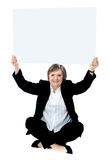 Seated businesswoman holding blank whiteboard Royalty Free Stock Photography