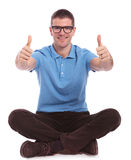 Seated casual man with both thumbs up Stock Image