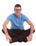 Seated casual man smiles for you Stock Photos