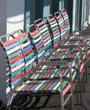 Seated Colors. Colorful, multi-colored, aluminum & vinyl chairs on Atlantic Beach, SC Stock Images